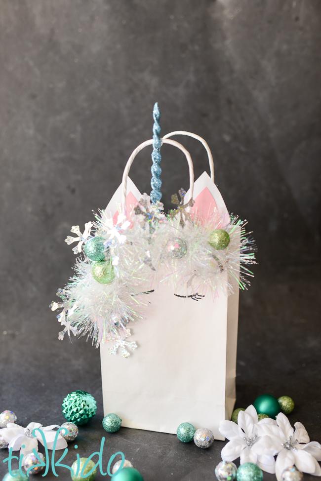 Make Christmas even more magical with this sparkly Christmas unicorn gift bag tutorial.