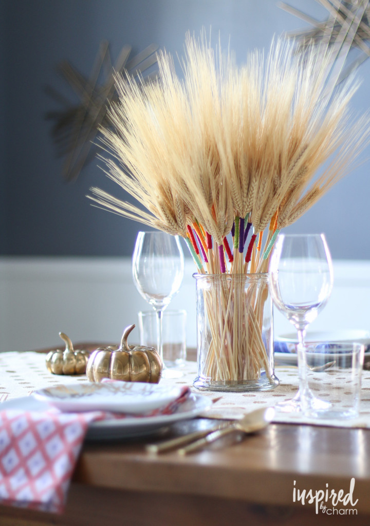 wheat thanksgiving centerpiece accented with wraps of colored embroidery floss