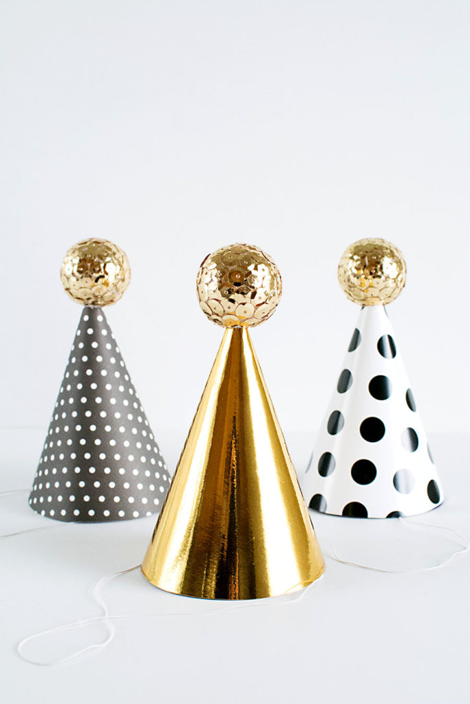 DIY New Year's Eve hats with sparkling sequin ball toppers
