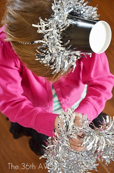 Turn a paper cup into a darling New Year's Eve party hat with this tutorial.